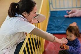 A volunteer spends time interacting with a young child as part of her Social Work internship in Bolivia.
