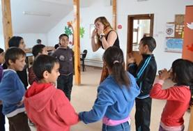 A Social Work volunteer works with a group of children at our placement in Romania.
