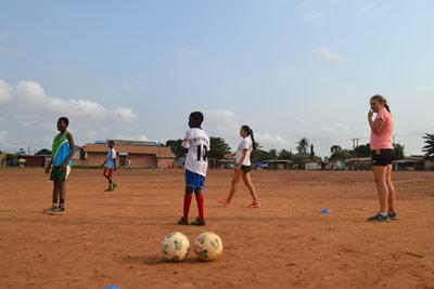 Projects Abroad Sports volunteers from Norway and the US train with children at a local sports club