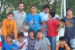 Multi-sports volunteers work with local children in Argentina on a community sports initiative to improve their fitness and technique.