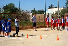 Local school children work on a soccer drill with a volunteer at our Multi-sports placement in Morocco.