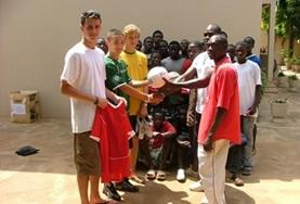 Soccer volunteers work together with local coaches to help children from developing countries to improve their soccer skills.
