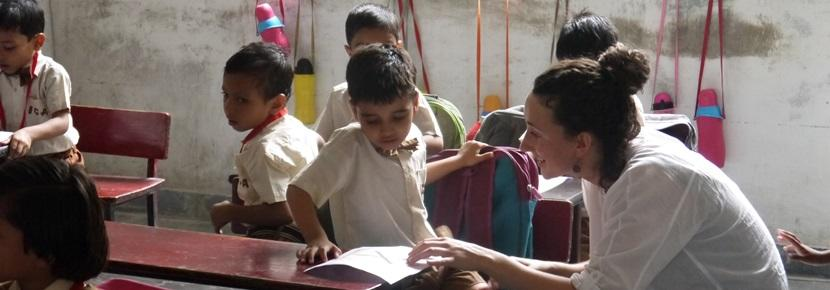 Projects Abroad volunteer works with children in an elementary school at their Care placement in Jaipur, India.