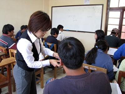 A volunteer teaches some of her adult learners at a university in Bolivia, Latin America.