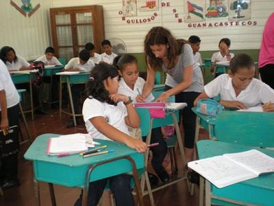 A volunteer teaches one of her students at a school in Costa Rica, Latin America.