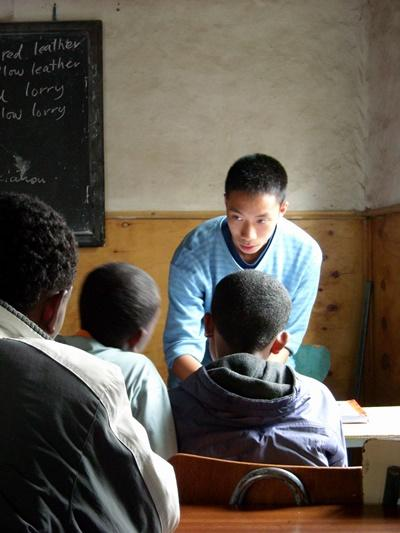 A Projects Abroad volunteer teaches English to his class in Ethiopia, Africa.