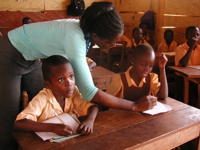 A volunteer helping her pupils in Ghana, Africa.