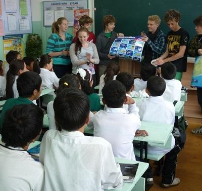 Volunteers have fun teaching their class in Mongolia, Asia.