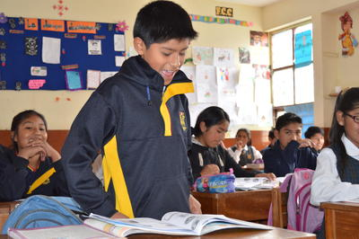 A young boy answers a question in the volunteer teaching placement in Peru