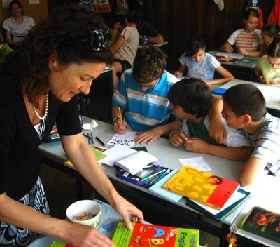 A Projects Abroad volunteer smiles in her classroom in Romania, Eastern Europe.