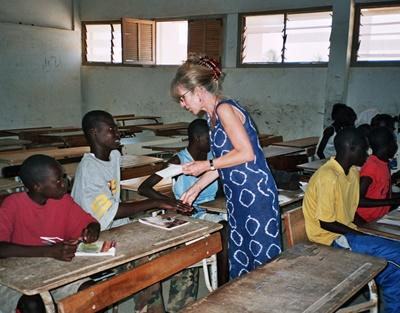 A volunteer assists one of her students in Senegal, Africa.