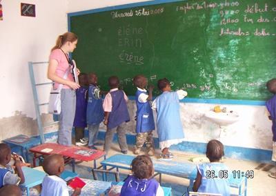 A volunteer helps her class in Senegal, Africa.