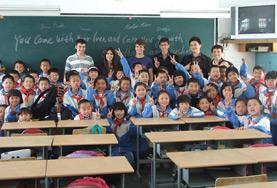 A Teaching volunteer poses with her class from a local school in China.