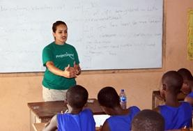 A Teaching volunteer explains concepts to a classroom of students at a school in Madagascar.