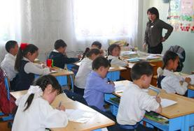 A volunteer works through an English language exercise with school students at our Teaching placement in Mongolia.