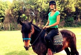 An Equine Therapy volunteer practises riding one of the therapy horses at her Care placement in Argentina.