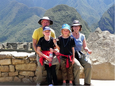 A family volunteering in Peru pose for a group picture
