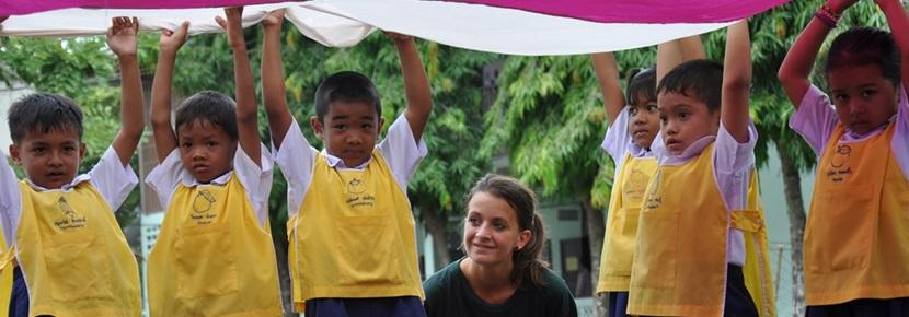 Volunteer playing with children at care project in Thailand