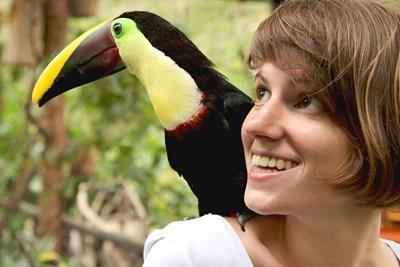 Projects Abroad volunteer with a toucan in Barra Honda National Park in Costa Rica