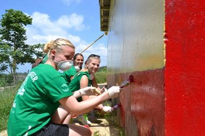 Projects Abroad Jamaica volunteers painting the Bryce Primary School bathrooms